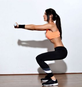 Faire des squats pour grossir les fessiers